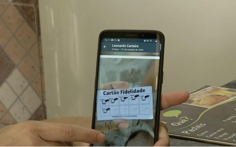 Casal encontra carteira em praia de Florianópolis e devolve para o dono em Goiás — Foto: Reprodução/TV Anhanguera