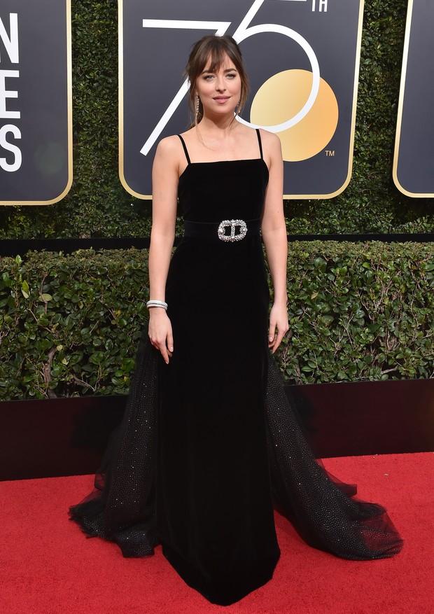 Dakota Johnson veste Gucci (Foto: Getty Images)