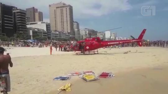 Helicóptero dos Bombeiros pousa na Praia de Ipanema para fazer resgate de afogado; vídeo