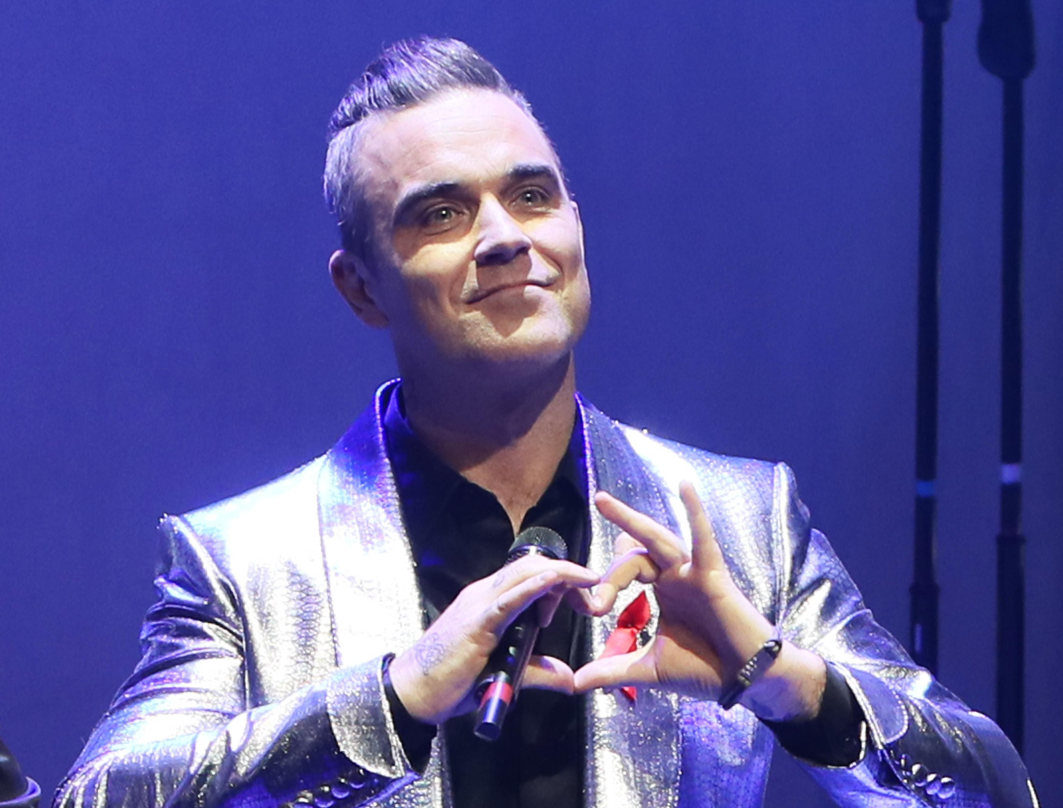 Robbie Williams é obrigado a substituir árvores que deixou morrer (Foto: Getty Images)