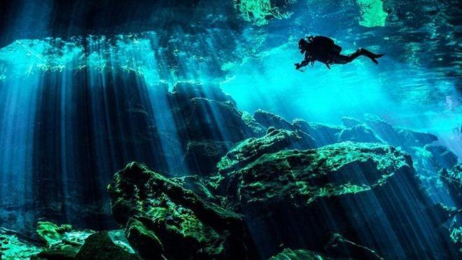 Para os antigos maias, cenotes eram portais sagrados através dos quais as pessoas se comunicavam com os deuses da chuva e da criação (Foto: Getty Images)