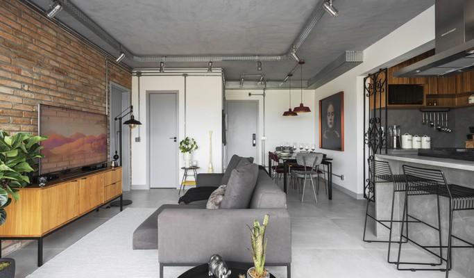 Apê de 61 m² ganha mais espaço e estilo industrial para receber bem