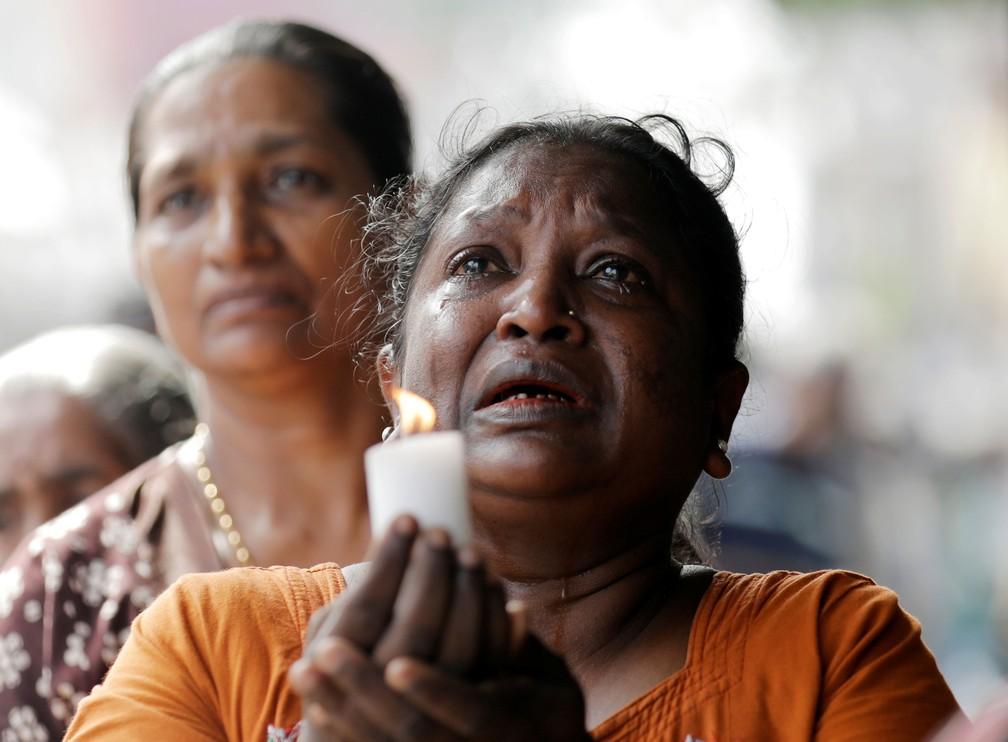 Sri Lanka fez minuto de silêncio nesta terça-feira (23) em homenagem às vítimas de ataques  — Foto: Dinuka Liyanawatte/ Reuters