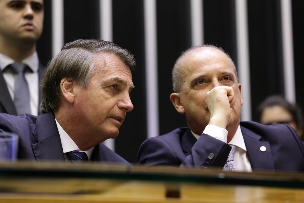 O ministro Onyx Lorenzoni, da Casa Civil, ao lado do presidente Jair Bolsonaro — Foto: Michel Jesus/ Câmara dos Deputados