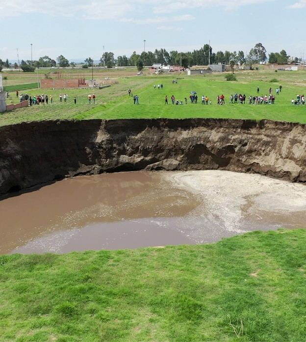 An aerial view of a sinkhole found in a farmland in Santa Maria Zacatepec, Puebla, Mexico May 30, 2021 is shown in this screen grab obtained from a social media video. Agencia Es Imagen/via REUTERS THIS IMAGE HAS BEEN SUPPLIED BY A THIRD PARTY. MANDATORY