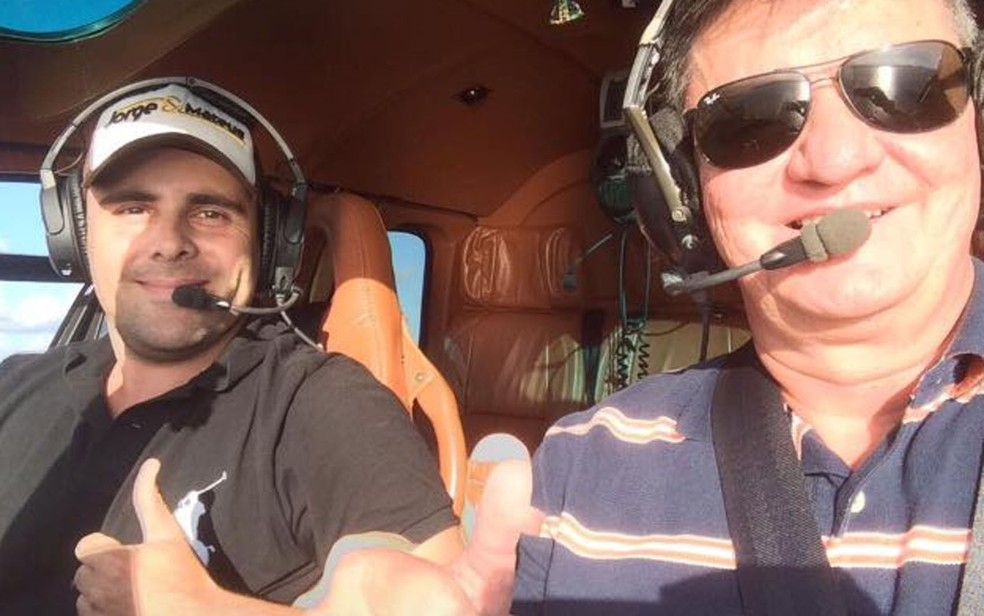 Felipe Ramos e coronal da PM em helicóptero (Foto: Redes sociais)
