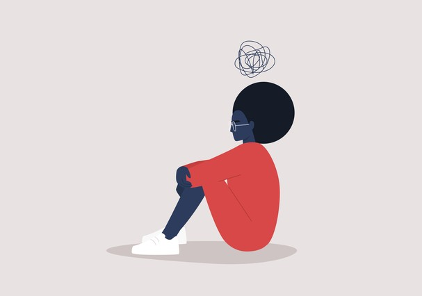Young black depressed female character sitting on the floor and holding their knees, a cartoon scribble above their head, mental health issues (Foto: Getty Images/iStockphoto)