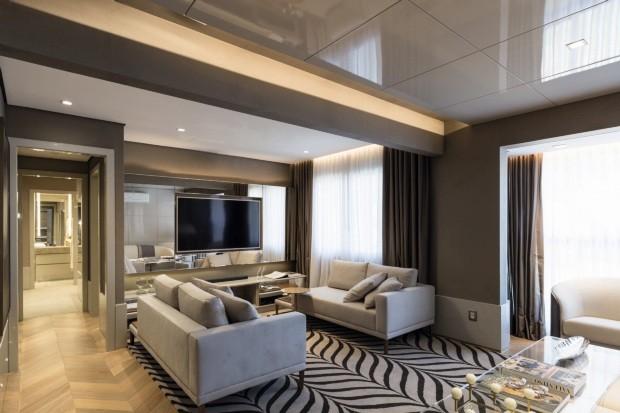 Um apartamento de 99 m² repleto de materiais nobres e móveis de design
