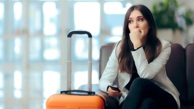 Em algumas empresas, os funcionários tiram menos dias de férias quando não há um limite estabelecido (Foto: Getty Images/BBC)