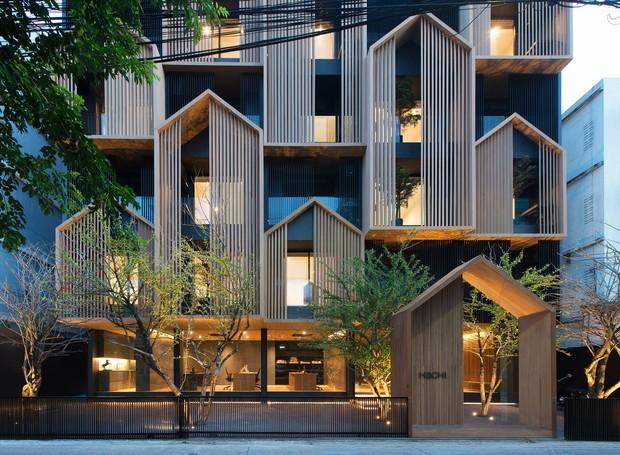 Edifício em Bangkok tem casinhas de madeira na fachada