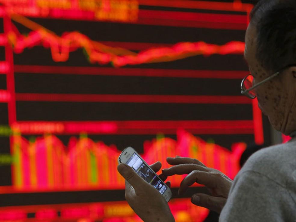 Bolsas da China têm forte queda com guerra comercial (Foto: Reuters)