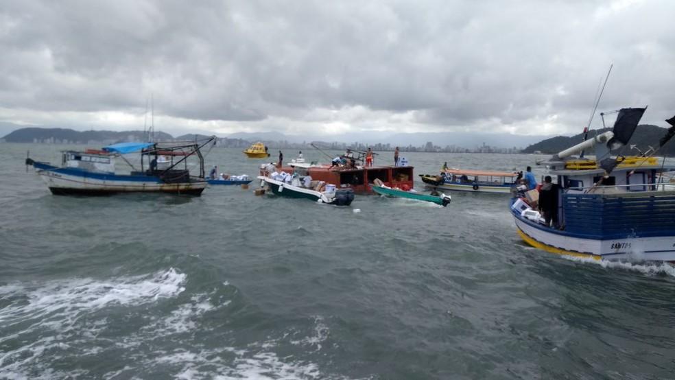 Imagem registra ação de saqueadores próximo à fileira de contêineres  (Foto: G1 Santos)
