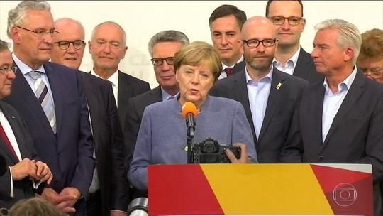 Merkel busca aliados após vitória apertada na Alemanha