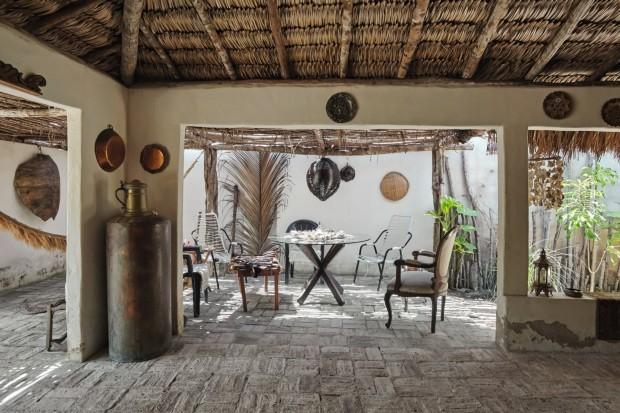 Sem portas nem janelas, moradora transforma bar em casa no Piauí (Foto: Ilana Bessler)