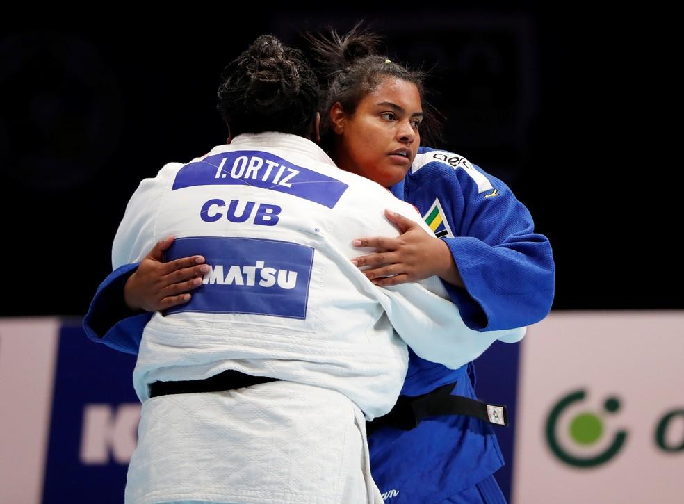 Maria Suelen na derrota para Idalys Ortiz, de Cuba — Foto: REUTERS / Issei Kato