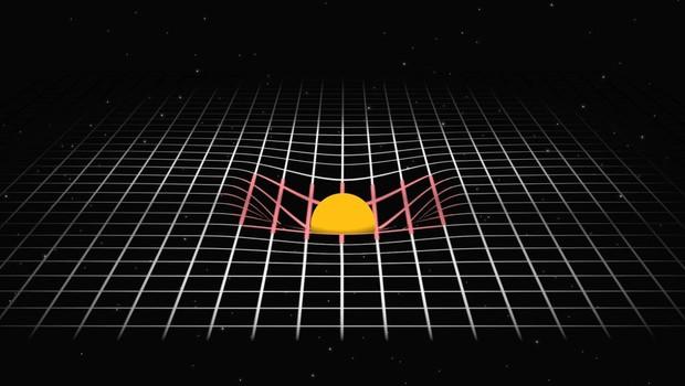 Einstein explicou a gravidade como a curvatura criada por um corpo massivo, como o Sol, no tecido do espaço-tempo (Foto: BBC)