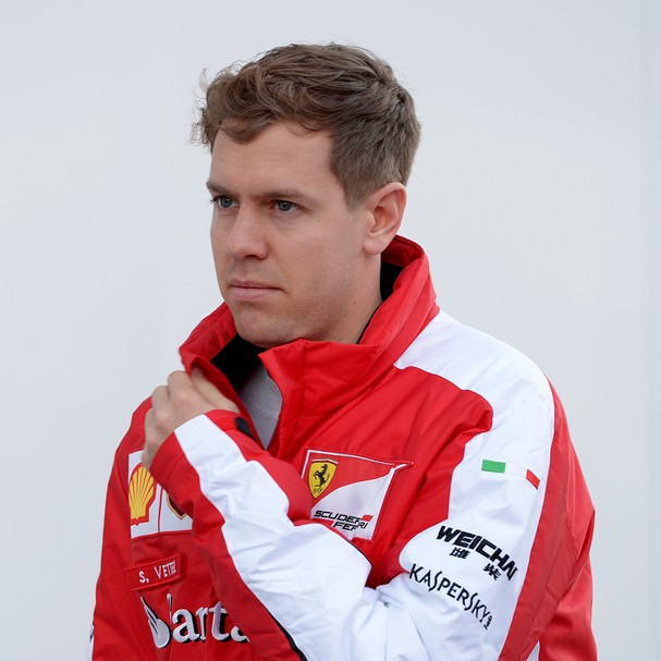 01 Feb 2015, Jerez de la Frontera, Spain --- German Formula One driver Sebastian Vettel of Scuderia Ferrari walks on the paddock during the training session for the upcoming Formula One season at the Jerez racetrack in Jerez de la Frontera, Southern Spain
