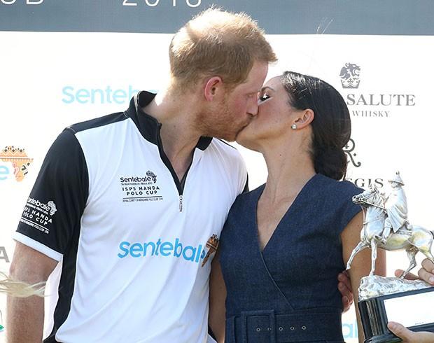 Harry e Meghan Markle: beijo após partida (Foto: Getty Images)
