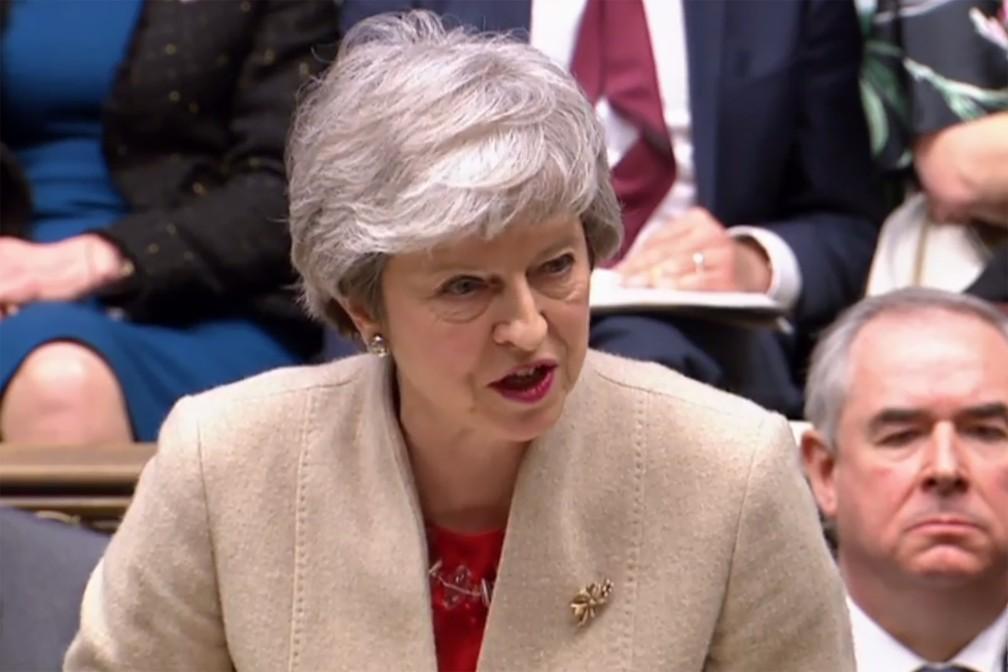 Theresa May fala no parlamento britânico nesta sexta-feira (29) — Foto: PRU/AFP