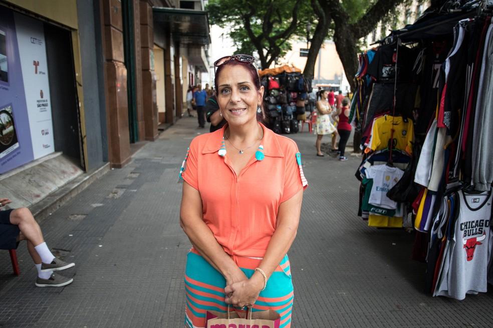 Rita de Cássia Sidney pagou a maior parte de suas dívidas e pôde realizar seu sonho de fazer uma viagem internacional (Foto: Fabio Tito/G1)