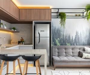 Apartamento de 20 m² é marcado pela integração, tons sóbrios e plantas