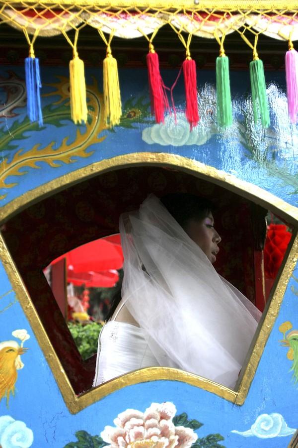 Cadeira Sedan em casamento chinês (Foto: Getty Images)