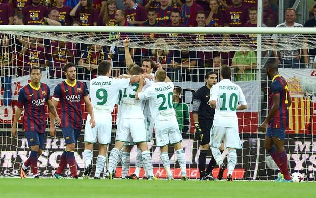 Lechia comemora gol contra o Barcelona (Foto: Agência AFP)