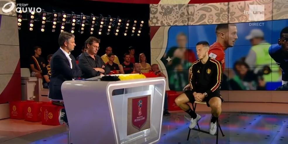 Hazard dá entrevista por holograma à emissora da Bélgica (Foto: Reprodução)