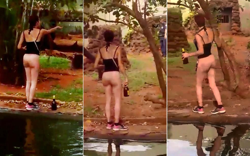 Travesti embriagada pula no recinto das onças no Bosque e Zoológico de Ribeirão Preto — Foto: Divulgação