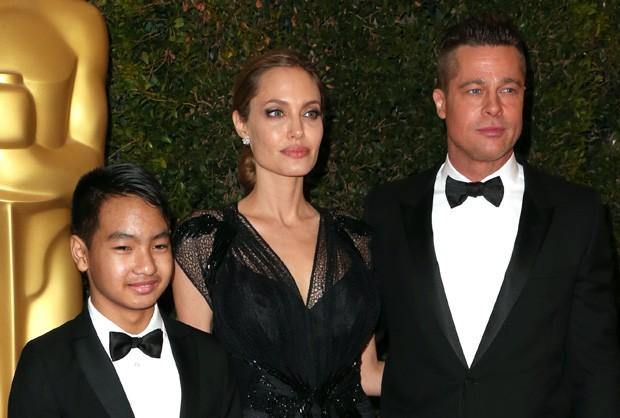 Angelina Jolie e Brad Pitt com Maddox em 2013 (Foto: Getty Images)