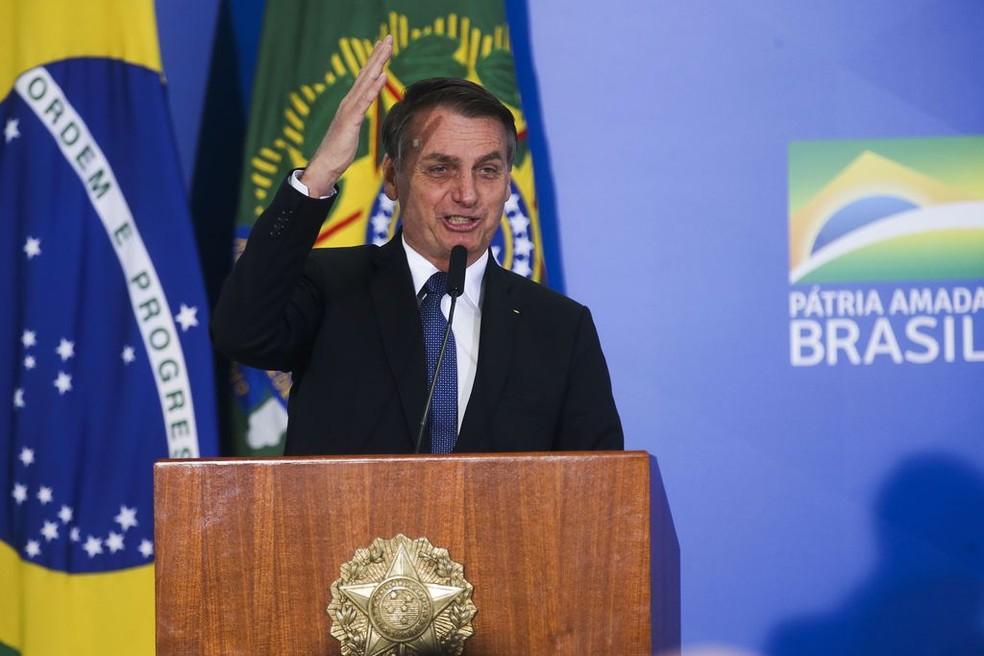 O presidente Jair Bolsonaro durante solenidade na manhã desta quinta-feira (13), no Palácio do Planalto  — Foto: Antonio Cruz/ Agência Brasil