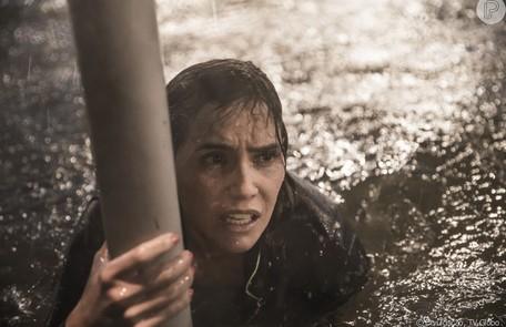 A atriz elege a cena do furacão como desafiadora: 'Fazia frio. E a sensação ao gravar de estar num filme de Hollywood.' Reprodução/Globo