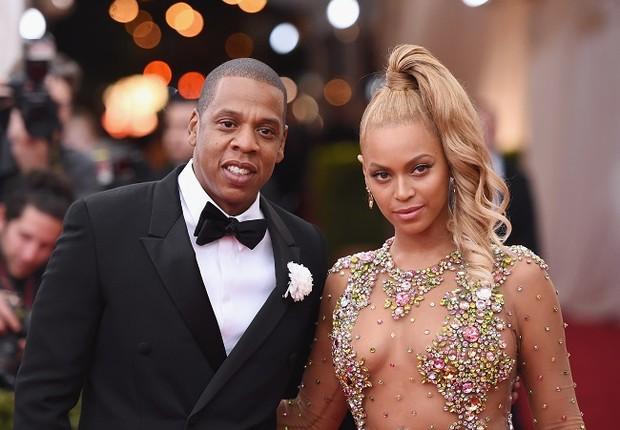 O rapper Jay-Z ao lado da esposa e cantora Beyoncé (Foto: Mike Coppola/Getty Images)