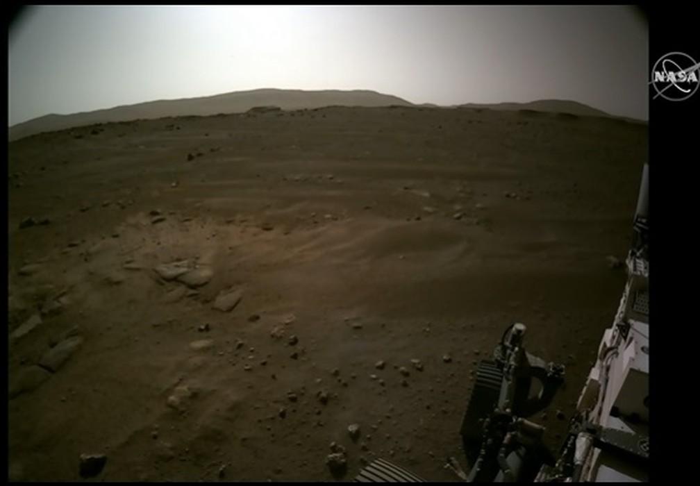 Momento em que o robô Perseverance toca o solo de Marte, no dia 18 de fevereiro. — Foto: Nasa