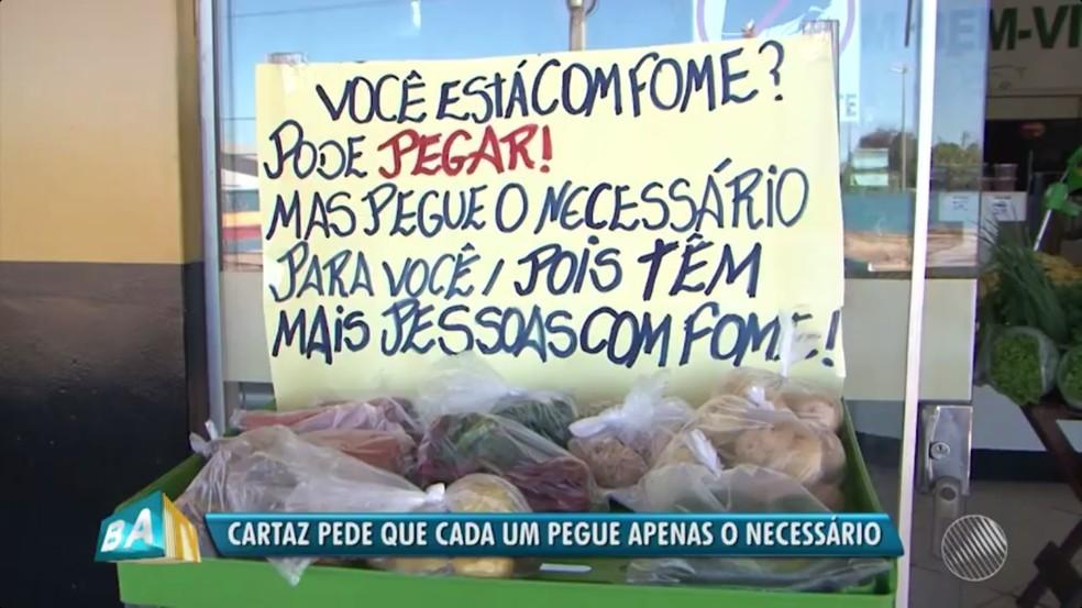 Placa avisa para pegar somente o necessário (Foto: Reprodução/TV Bahia)