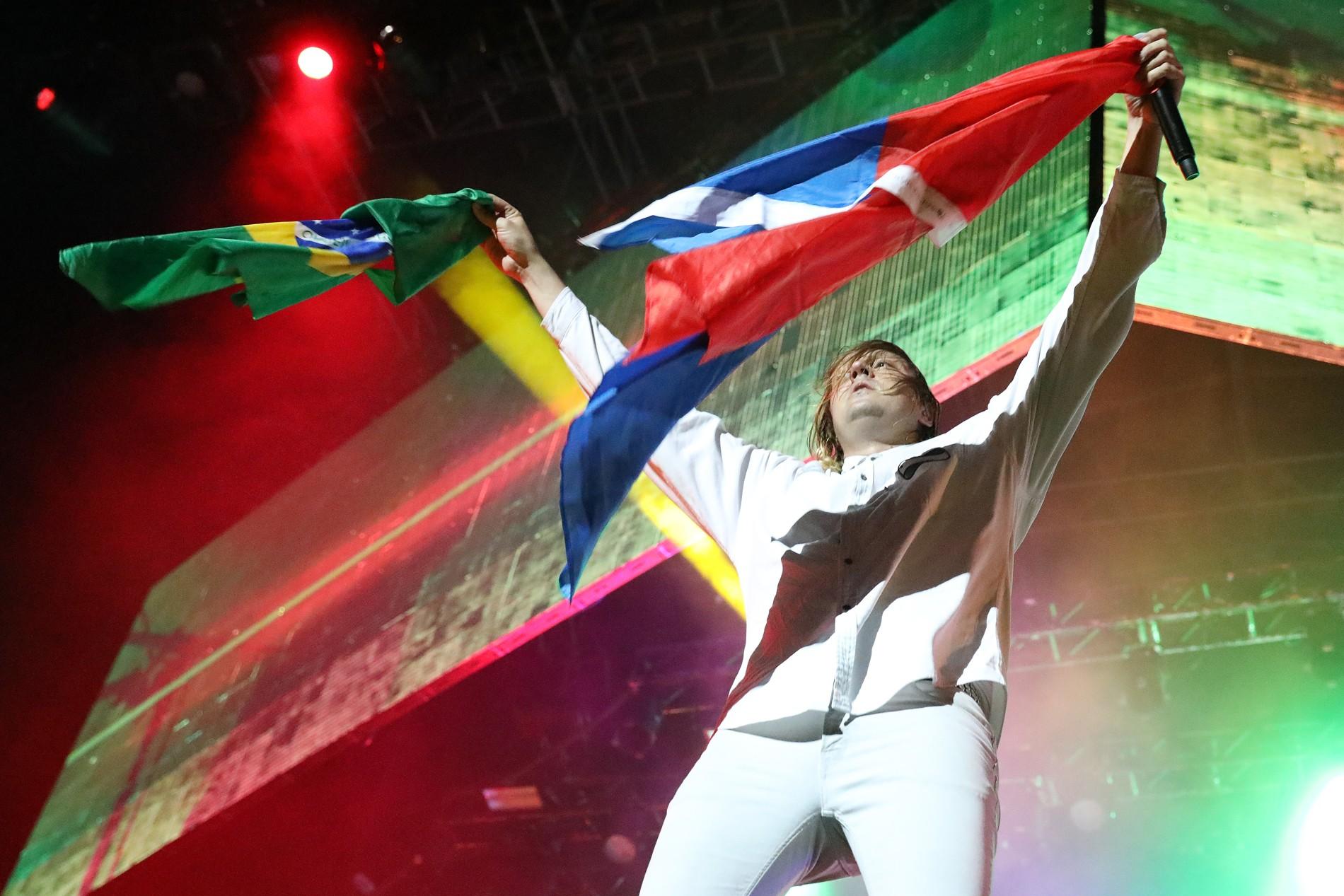 Arcade Fire reforça relação com Brasil, da Tropicália ao baile funk: 'Música de rua brasileira é incrível'