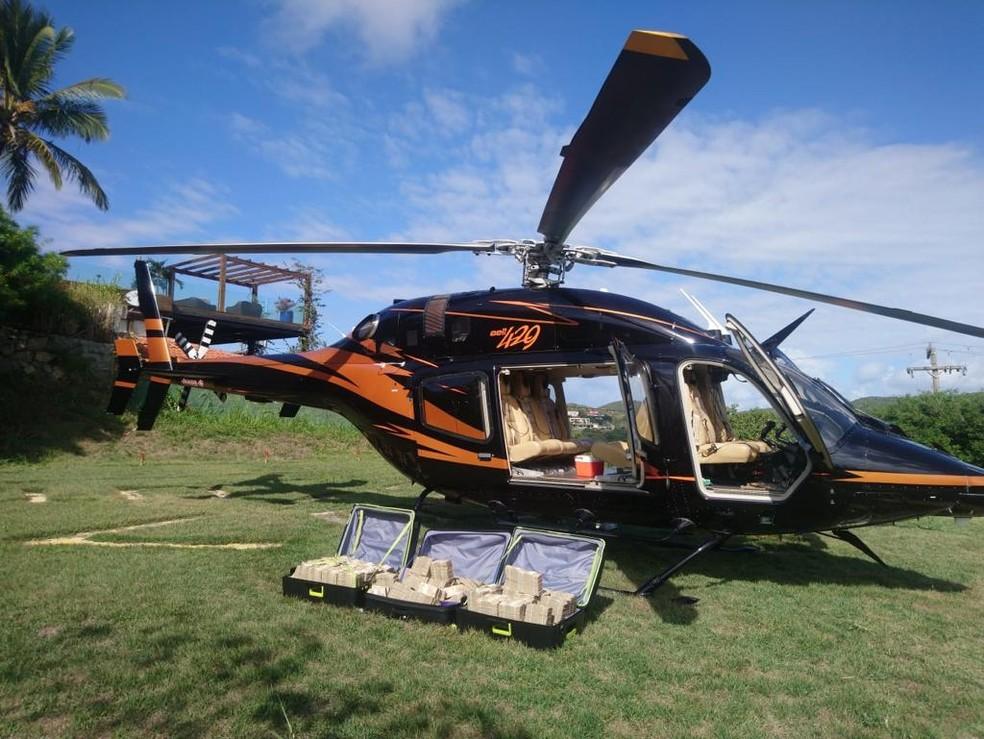 Dinheiro seria levado de Búzios, RJ, para São Paulo em um helicóptero — Foto: Divulgação/PF