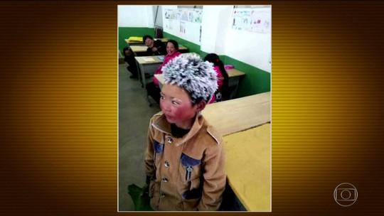 Garoto chinês chega à escola com cabelos congelados pelo frio e foto viraliza