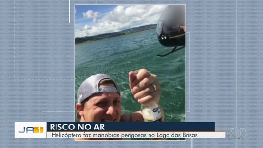 Cantor sertanejo filma helicóptero voando a poucos metros de lancha, em Buriti Alegre