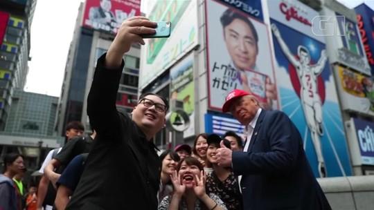 Sósias de Trump e Kim Jong-un passeiam por Osaka, no Japão, antes do início do G20
