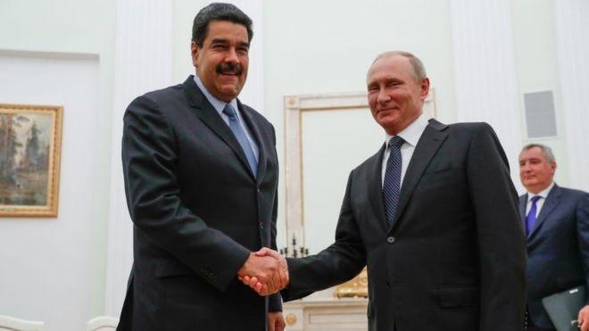 Vladimir Putin tem apoiado o governo de Nicolás Maduro (Foto: Getty Images/BBC)