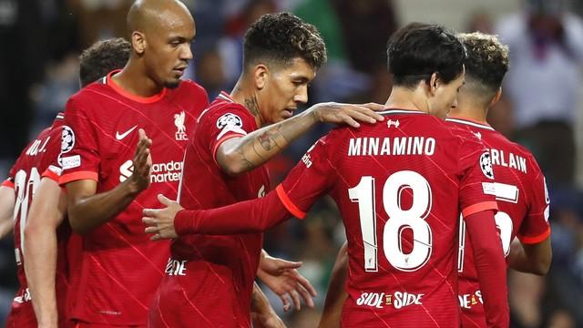 Firmino comemora um de seus gols na goleada do Liverpool sobre o Porto na Champions