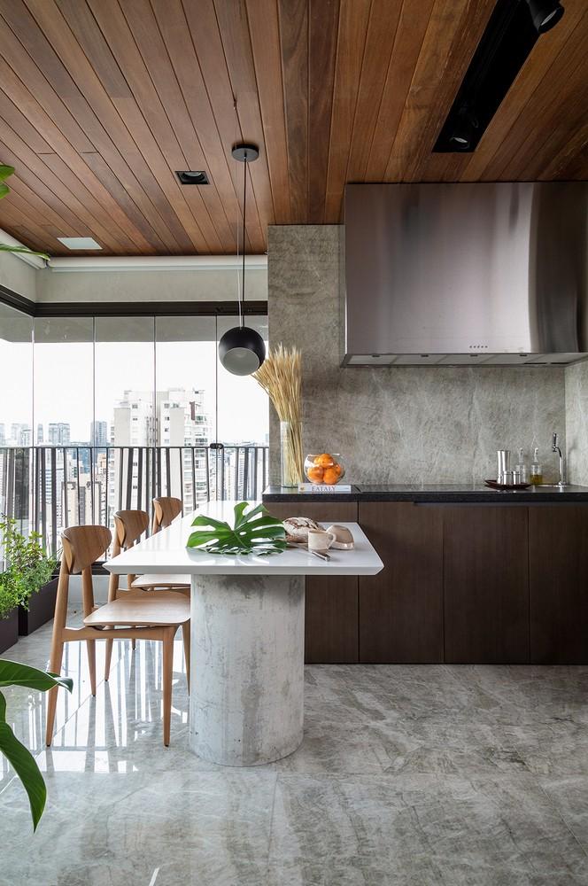 Décor do dia: cozinha integrada com mármore e painel ripado (Foto: Evelyn Müller)