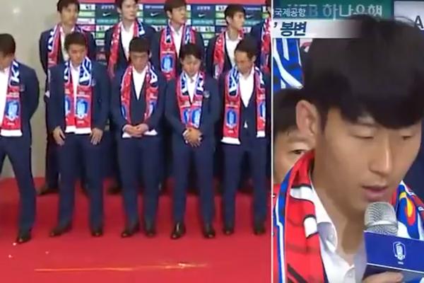 Os jogadores da Coreia do Sul recebidos com ovadas por seus trocedores após a eliminação na Copa do Mundo (Foto: Reprodução)