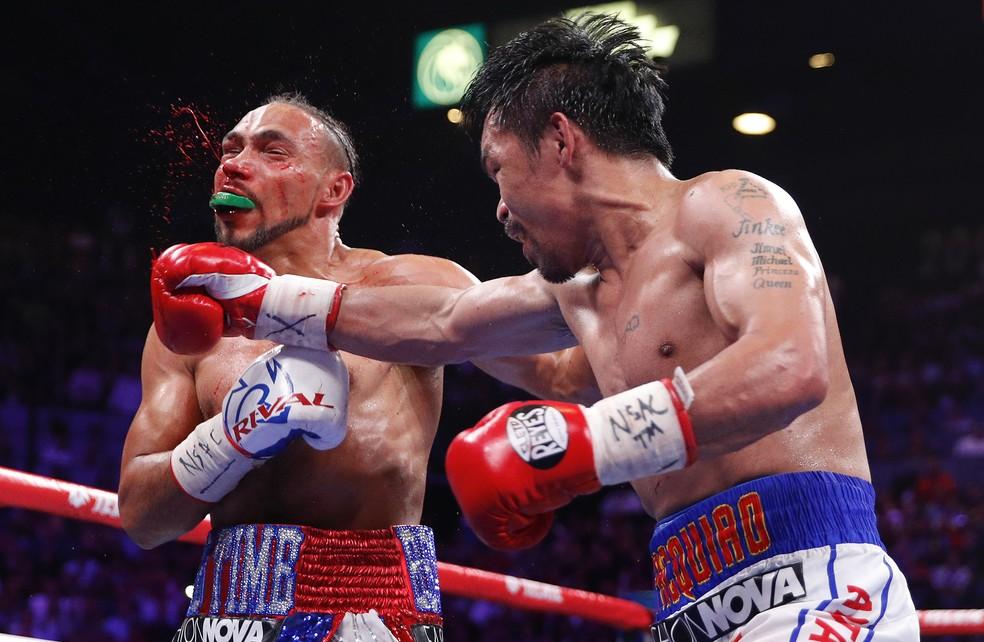 Pacquiao venceu Thurman em decisão dividida para conquistar título aos 40 anos — Foto: AP Foto/John Locher