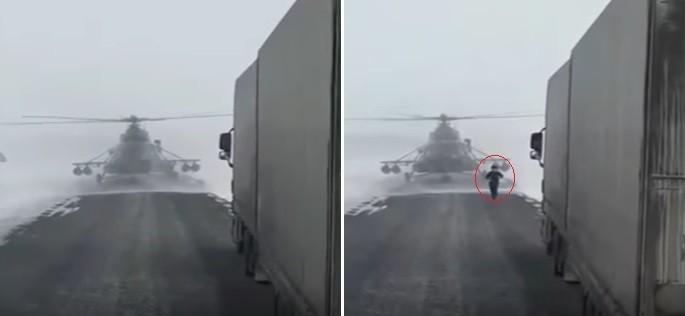 Piloto desce para pedir informação a motorista de caminhão