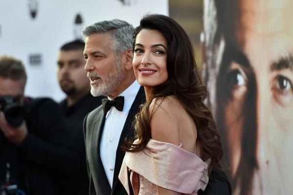 A advogada Amal Clooney e o marido, o ator George Clooney (Foto: Getty Images)