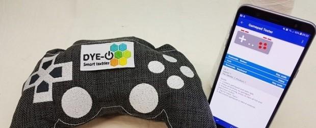 Dye-IO: tecido sensível ao toque possibilitará a interatividade da roupa com dispositivos móveis, como computadores, Smart TVs e celulares (Foto: Reprodução)