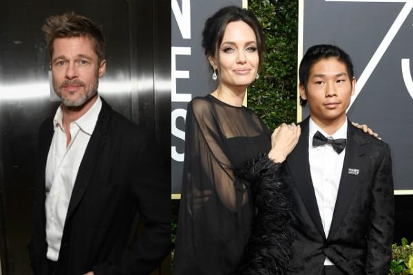 O ator Brad Pitt e a atriz Angelina Jolie na companhia do filho Pax (Foto: Getty Images)
