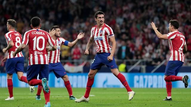 Savic comemora seu gol, o primeiro da reação do Atlético contra a Juve